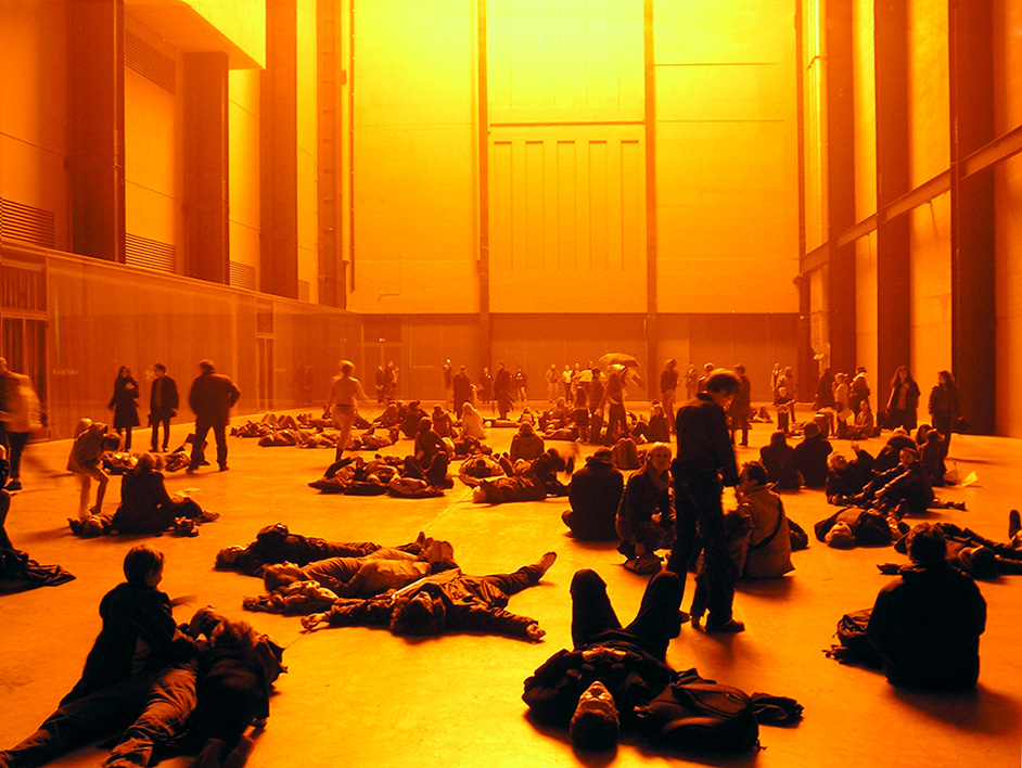 People enjoying Olafur Eliasson's The Weather Project at the Tate Modern, London, 2003.
