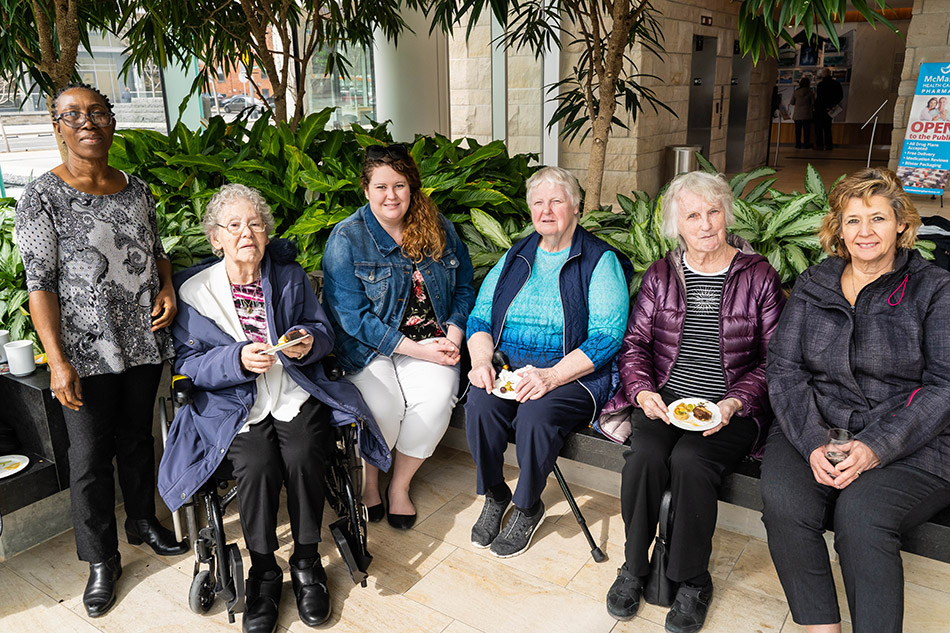 Artful Moments participants attending the exhibition opening reception with family and friends